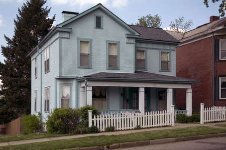 A craftsman style house. Nice little picket fence to set it off.