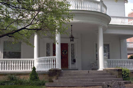 spindles: A huge front porch in the Greek revival style is the main feature of this beautiful home. Fantastic detail in the spindles and trim work.
