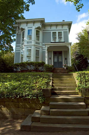 Perched on a small hill this house invites you to climb is stone staircase. Located in the historic Lancaster Ohio. Stok Fotoğraf