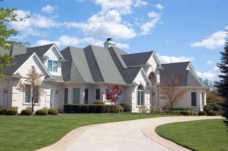 Beautiful, large and expensive  new home. This house features lots of roof peaks and a circular driveway. Just one of many new home or house photos in my gallery. Stock Photo - 409719