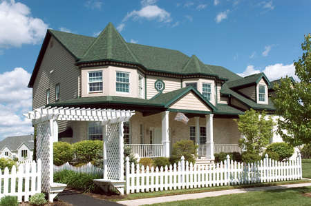 New home with a Victorian flavor architecture. Just one of many new house photos in my gallery. Stock Photo - 409714
