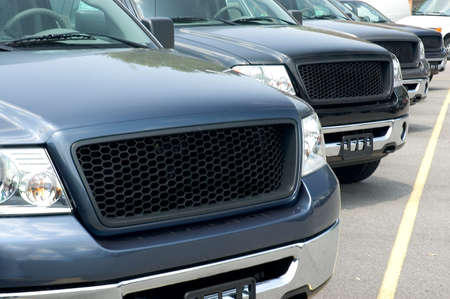 A row of luxury suvs ready for the market. Editorial