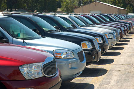 Rows of sport utility vehicles , SUVS, for sale on a car dealers lot. Look for many more car type photos in my gallery.