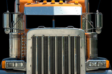 Intimidating view of the very macho looking front end of a large powerful semi truck.