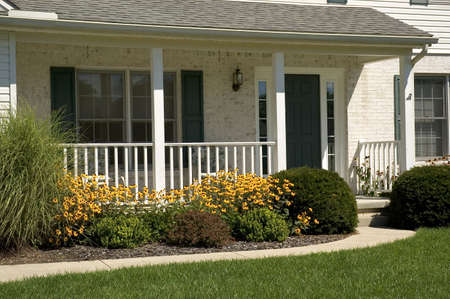 front porch: Front porch and entrance of a nice white brick home. Stock Photo
