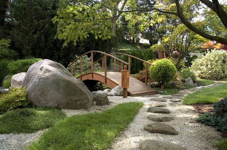 Beautiful and peaceful Japanese water garden. Complete with a bridge, stone paths  and several small waterfalls.