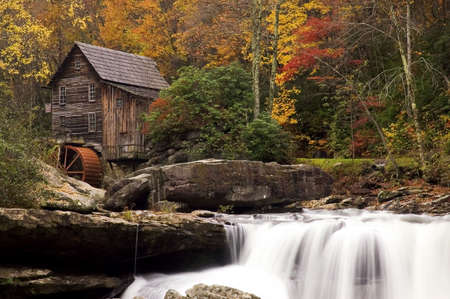 Beautiful colorful October autumn colors surround the Glade Creek Grist mill in West Virginia. A very popular destination for tourism in the fall. One of several of this mill I have in my gallery.