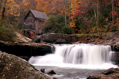 Beautiful colorful October autumn colors surround the Glade Creek Grist mill in West Virginia. A very popular destination for tourism in the fall. One of several of this mill I have in my gallery. photo
