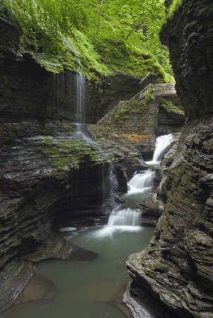Rainbow Falls at Watkins  Glen state park in New York. Lush green spring colors along the stream add to the beauty of the scene.  One of many waterfalls in my collection. photo