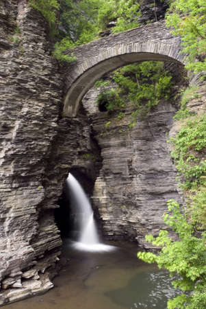 Watkins  Glen state park in New York.   The gorge trail and stone bridges where constructed in the 1930s and blend in amazingly well with the natural surroundings of the gorge. Its hard to tell where the man made walls start and end, quite an accomplishm