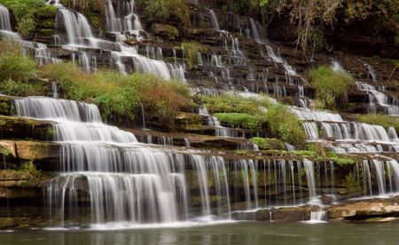 A amazingly beautiful series of cascades down a gorge wall. The water source is an underground cavern which pours the water out the side of the gorge wall. The wall is filled with beautiful ferns and vines and the water stair steps its way down the many l