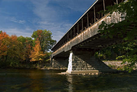 Saco River Bridge in North Conway New Hampshire on a beautiful autumn day. photo