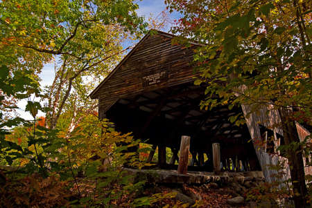 covered bridge: Albany Covered Bridge in New Hampshire on a beautiful autumn day. Bridge was built in 1858.