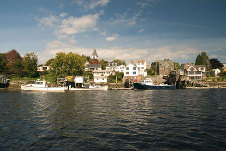 lobster boat: Lobster boats docked in Portsmouth harbor New Hampshire. A typical small New England fishing village.