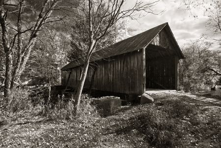 Black and white photo of an old covered bridge in New Hampshire.