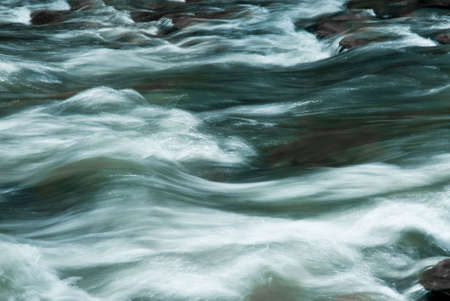 downstream: A close look at water as it tumbles over rocks on its way downstream.  Stock Photo