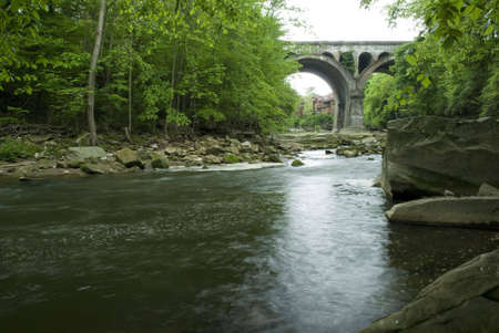 stone arches: A view of an old  bridge  located in Olmstead Falls Ohio. Beautiful architectural design with its stone arches.