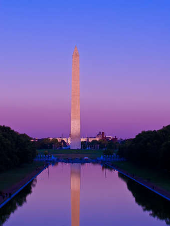 The Washington Monument at sunset reflecting into the pool. Located in Washington DC. Stock Photo