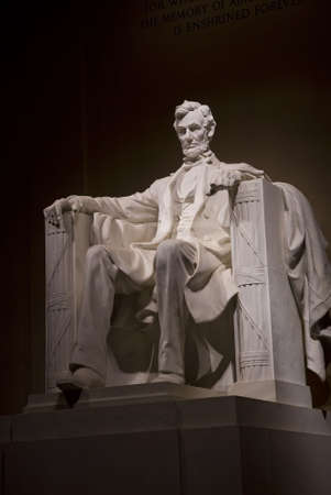 abraham lincoln: A night time shot of Abraham Lincolns statue inside the Lincoln Memorial. Located on the National Mall in Washington DC.