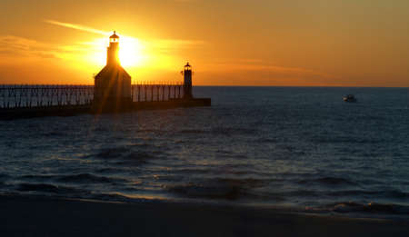St. Joseph North Pier Lights in St. Joseph, Michigan at sunset. photo