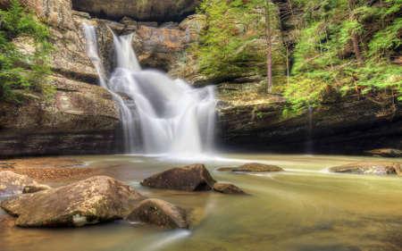 The very beautiful Cedar Falls  in Hocking Hills Ohio. Very popular tourist atraction. photo