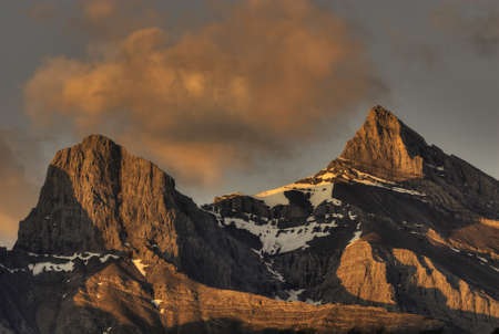 alberta: The Three Sisters mountains in Canmore Alberta Canada Stock Photo