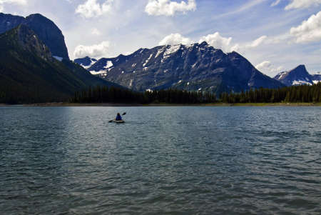 canmore: Canoeing on Spray lake in the Canadian Rockies near Canmore.