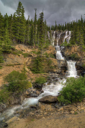 icefield: Tangle Falls in Jasper National Park, Alberta Canada. Seen along the Icefield Parkway. The waterfall is 100 feet high .