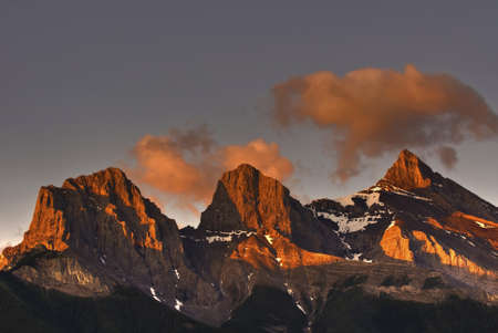canmore: The Three Sisters mountains in Canmore Alberta Canada Stock Photo
