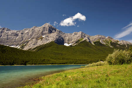Spray lakes with the Canadian Rockies in the background. Located in the Kananaskis Country near Canmore, Alberta Canada.  photo