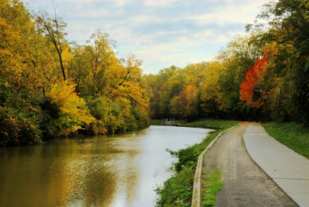 Beautiful Autmn colors along the old Erie Canal in Toledo Ohio  A replica canal boat is scen in the distance