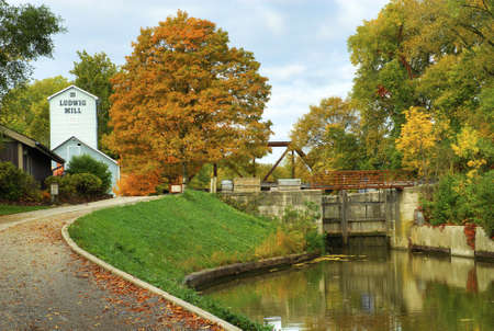 erie: The Historic Ludwig Mill surrounded by peak fall colors in Toledo Ohio  It