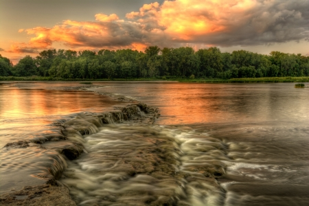A beautiful warm summer sunset at Weir s Rapids along the Maumee river in Northwest Ohio