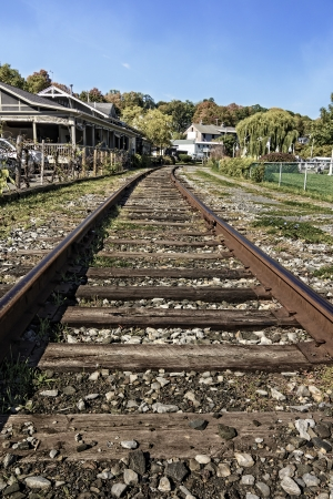 A view of train tracks as they approach a train depot  Seen in the quaint village of Watkins Glen New York