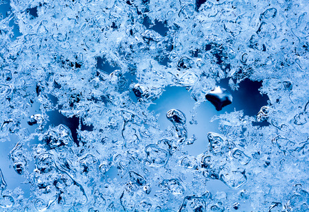 Closeup of melting snow crystals with a blue tint Great abstract winter background