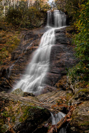 Dill Falls is a scenic 65 foot waterfall not far from the Blue Ridge Parkway in North Carolina.Seen here in autumn.