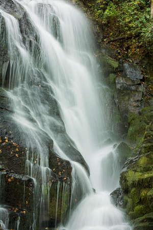 Eastatoe Falls is a beautiful 60 foot waterfall near Rosman North Carolina.Seen here in autumn. This is just a small portion of the falls showing the twist and turns of the water as it flows down.