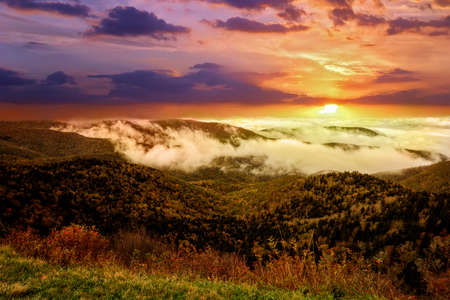 Spectacular early morning sunrise as fog settles into the valleys of the mountains along the Blue Ridge Parkway in Western North Carolina on a crisp autumn October day.