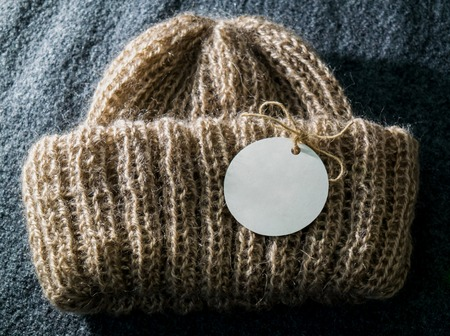 Warm and beautiful handmade brown winter hat for women with an emty tag on it