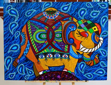 KIROV, RUSSIA - JUNE 5, 2017: Blue, red and yellow abstract elephant painting indian style