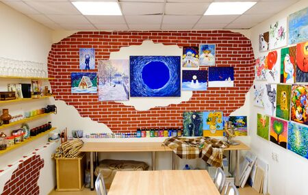 KIROV, RUSSIA - AUGUST 7, 2017: Colorful and creative interior of the local art studio, loft style, many original paintings and replicas on the walls