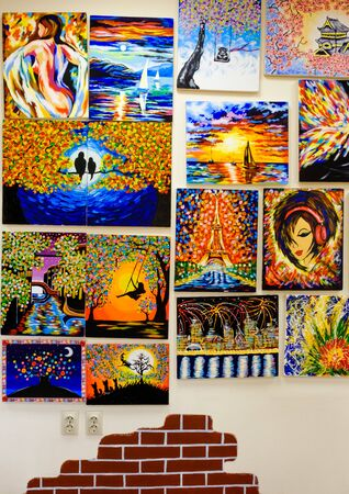 KIROV, RUSSIA - AUGUST 7, 2017: Many beautiful vibrant paintings on the wall of a local art studio, originals and replicas