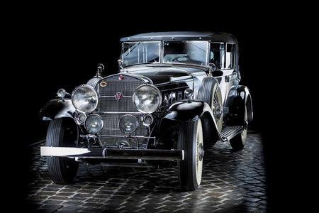 Cadillac V16 Adler Trumpf Junior brown luxury retro car Cabrio Limousine dark background Editöryel