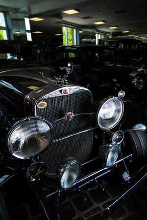 Cadillac V-16 vintage retro car Adler Trumpf Junior brown luxury retro car Cabrio Limousine dark background