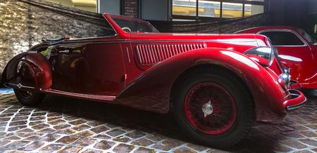 Alfa Romeo 6C 2300B retro car Adler Trumpf Junior brown luxury retro car Cabrio Limousine dark background