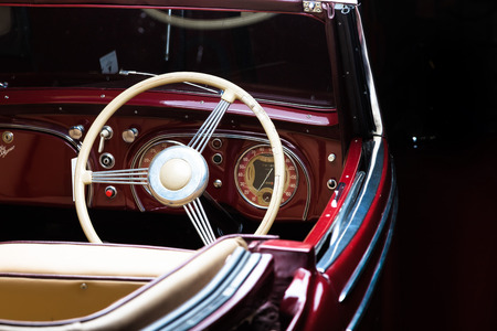 Adler Trumpf Junior brown luxury retro car Cabrio Limousine dark background