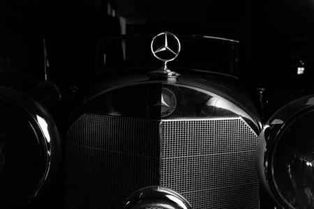 Mercedes logo retro car dark background Adler Trumpf Junior brown luxury retro car Cabrio Limousine dark background