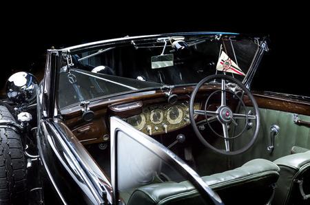 Mercedes-Benz 540K - Adler Trumpf Junior brown luxury retro car Cabrio Limousine dark background