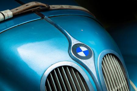 BMW retro car logo Adler Trumpf Junior brown luxury retro car Cabrio Limousine dark background Editöryel