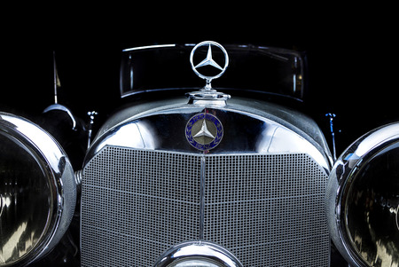Mercedes-Benz 170 V Adler Trumpf Junior brown luxury retro car Cabrio Limousine dark background